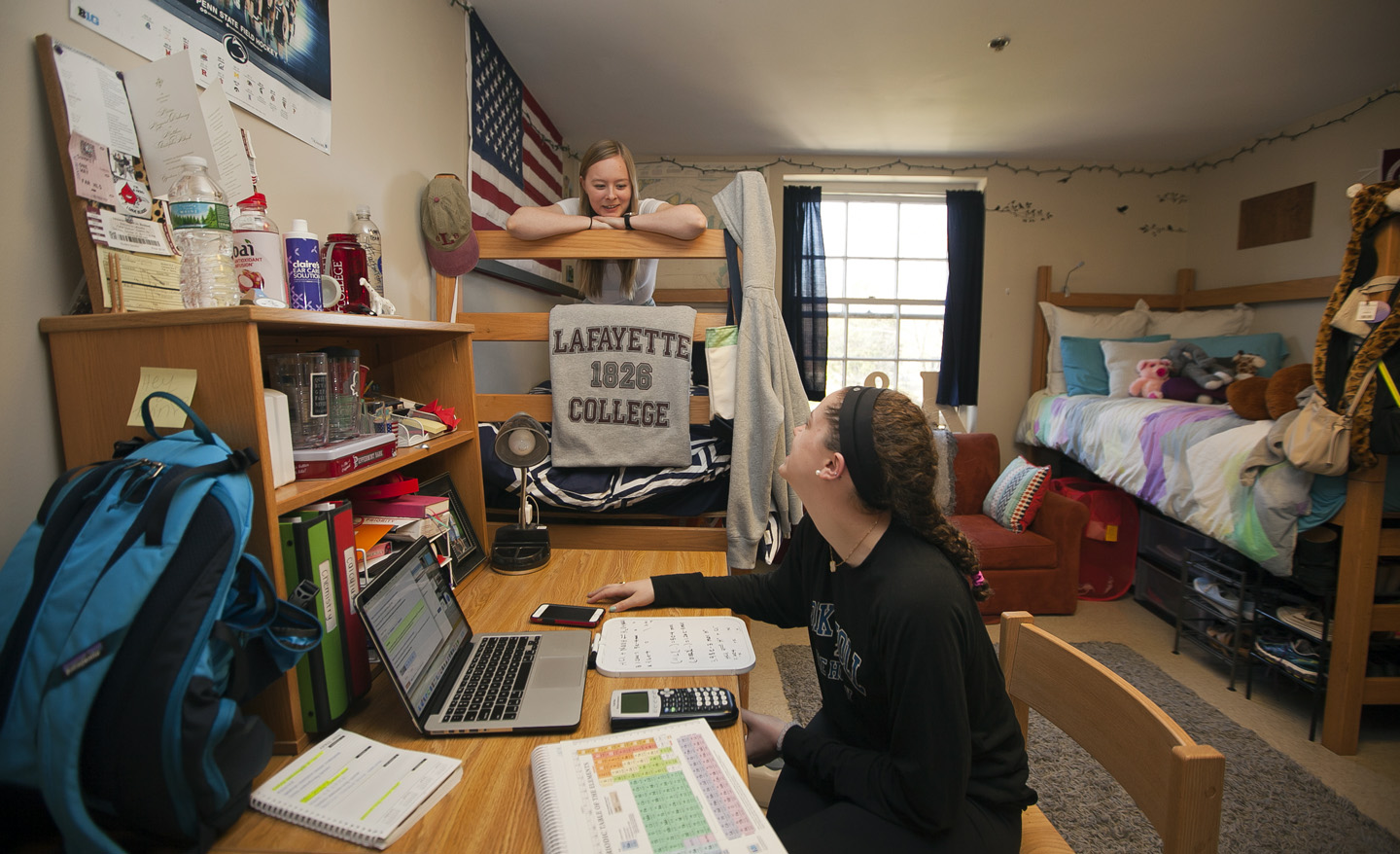 Lucy Khan '19 ( in white top, and Kathleen Conway '19 in dark top spend  time in their South College Dorm.  Chuck Zovko / Zovko Photographic llc  April 17, ...